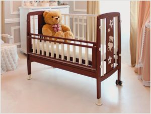 Особенности выбора приставных кроваток для новорожденных